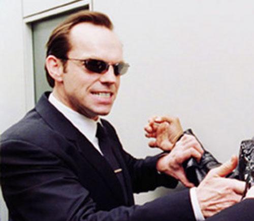 Agent Smith (Hugo Weaving in the Matrix) grabbing a human
