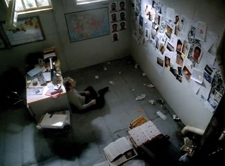 Alexander Mahone (William Fichtner) staring at photos