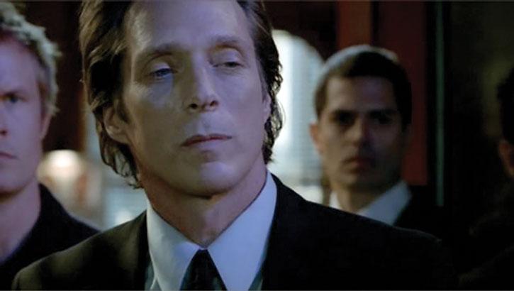 Alexander Mahone (William Fichtner) squinting