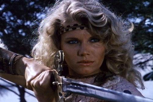 Amethea (Lana Clarkson in Barbarian Queen) face closeup with headband and sword