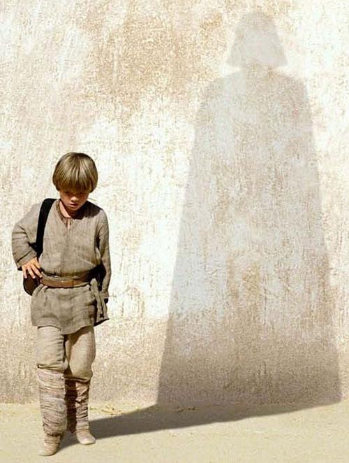 Anakin Skywalker (Jake Lloyd in Star Wars episode 1) casting a Darth Vader shadow