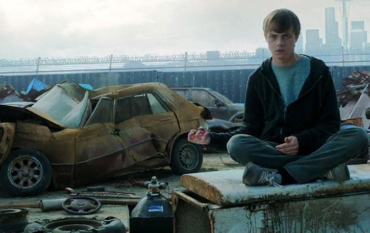 Andrew Detmer (Dane DeHaan) crushing a car