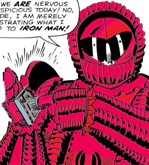 Crimson Dynamo (Anton Vanko) (Iron Man enemy) (Marvel Comics) using a gadget