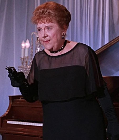 Aunt Harriet (Madge Blake in 1966 Batman TV show) in black with a snub nosed revolver