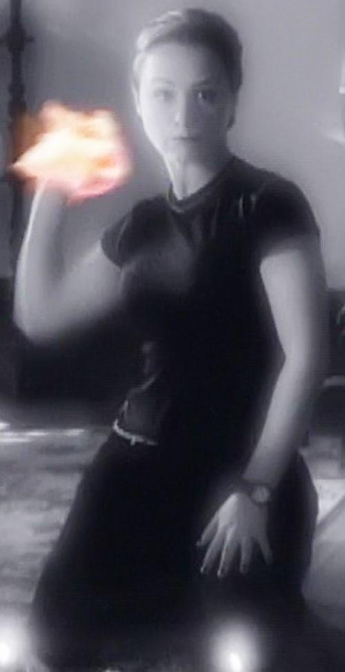Aviva (Danielle Harris in Charmed) with her hand on fire