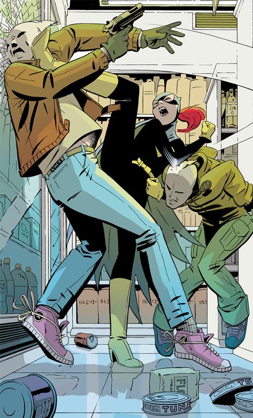 Batgirl (Barbara Gordon) (2003 Year One) beating robbers