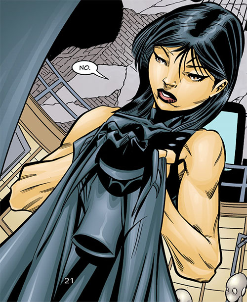 Batgirl (Classic Cassandra Cain) (DC Comics) holding her costume