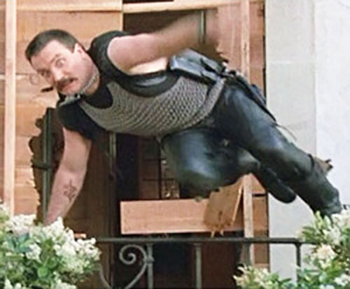 Bennett (Vernon Wells in Commando) leaping over a fence