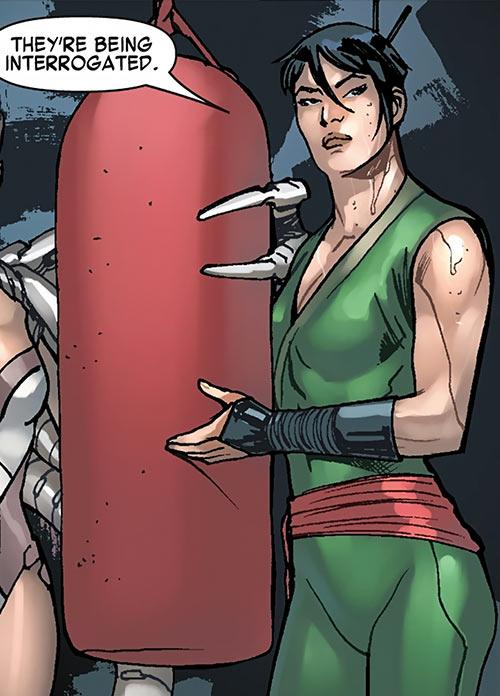 Black Lotus (Marvel Comics) with a boxing bag