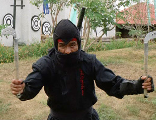 Black Star Ninja (Tadashi Yamashita in American Ninja) dual-wielding kama sickles