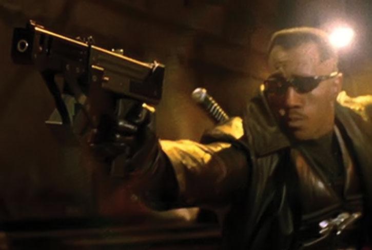 Blade wielding one of his machine pistols
