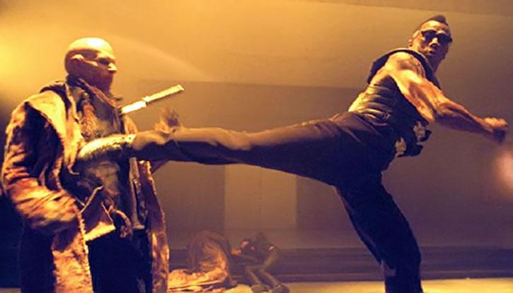 Blade (Wesley Snipes) kicks a master vampire