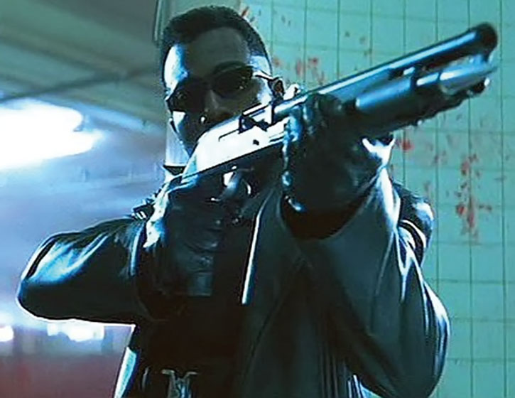 Blade aiming his shotgun