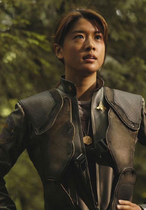 "Sharon ""Boomer"" Valerii (Grace Park in Battlestar Galactica) in a forest"