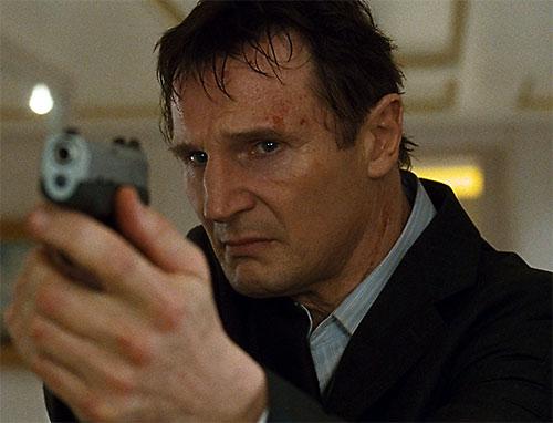 Bryan Mills (Liam Neeson in the Taken movie) pointing a pistol