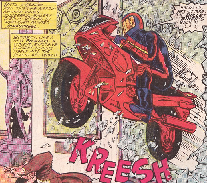 The Bullet Biker bursts through plate glass
