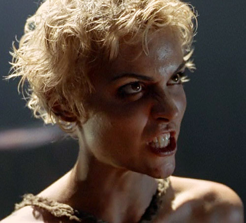 Callisto (Hudson Leick in Xena) short curly hair scowling