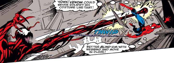 Carnage casts a battering ram at Spider-Man