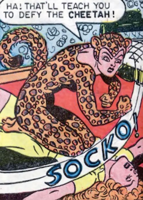 Cheetah of Earth-2 (Wonder Woman enemy) (Golden Age DC Comics) socking a woman