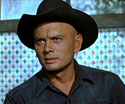 Chris Larabee Adams (Yul Brynner in the Magnificent Seven) next to a window