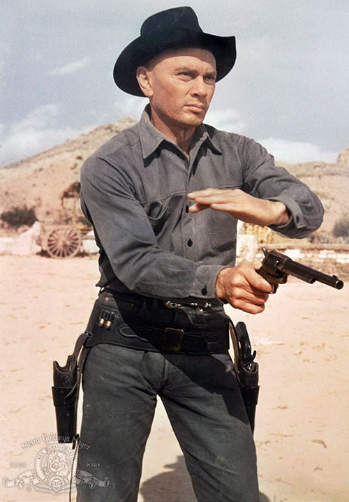 Chris Larabee Adams (Yul Brynner in the Magnificent Seven) firing a Peacemaker