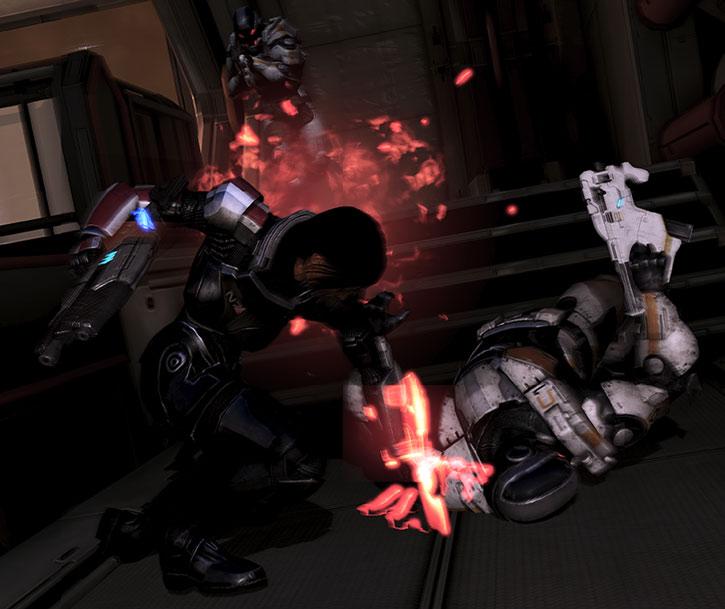 Commander Shepard stabs a Cerberus shock trooper