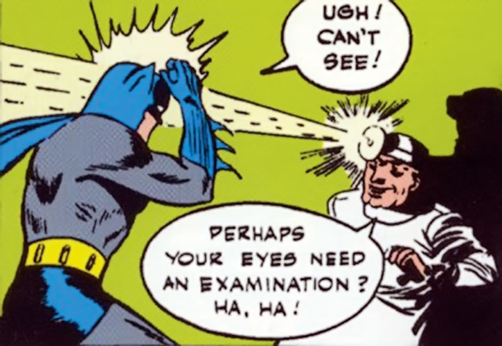 The Crime Doctor blinds the Batman with his headgear
