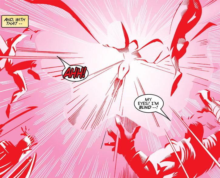 Crimson Cowl (Justine Hammer) releases a huge flash of light