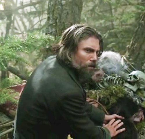 Cullen Bohannon (Anson Mount in Hell on Wheels) in a forest with a skull