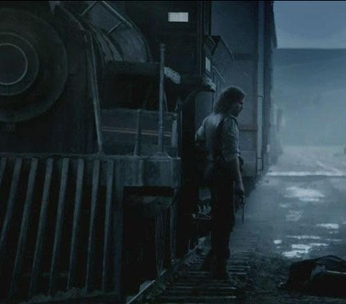 Cullen Bohannon (Anson Mount in Hell on Wheels) near a locomotive