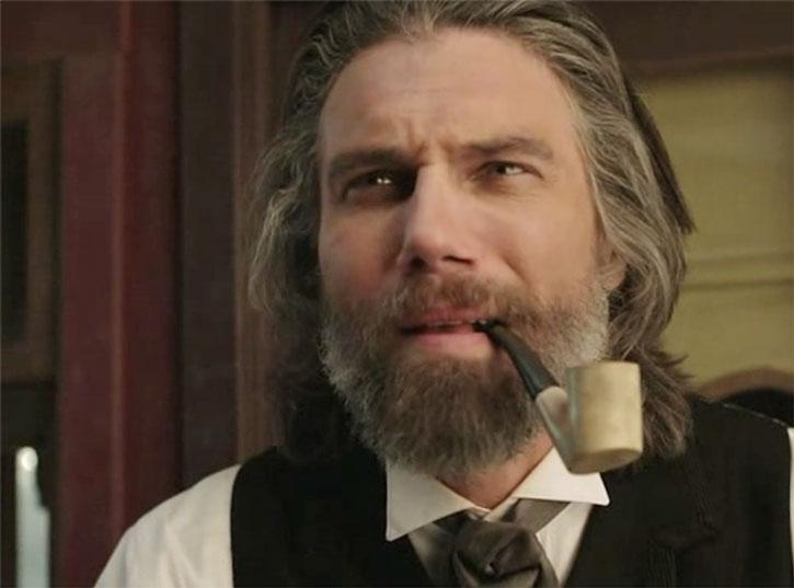 Cullen Bohannon (Anson Mount) smoking a pipe