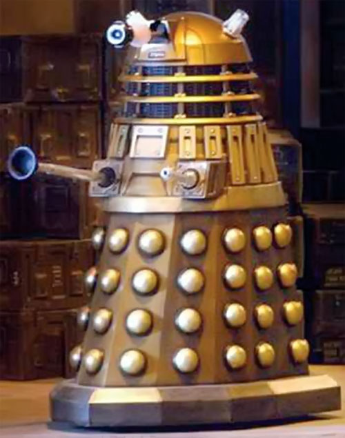 Dalek passing before crates