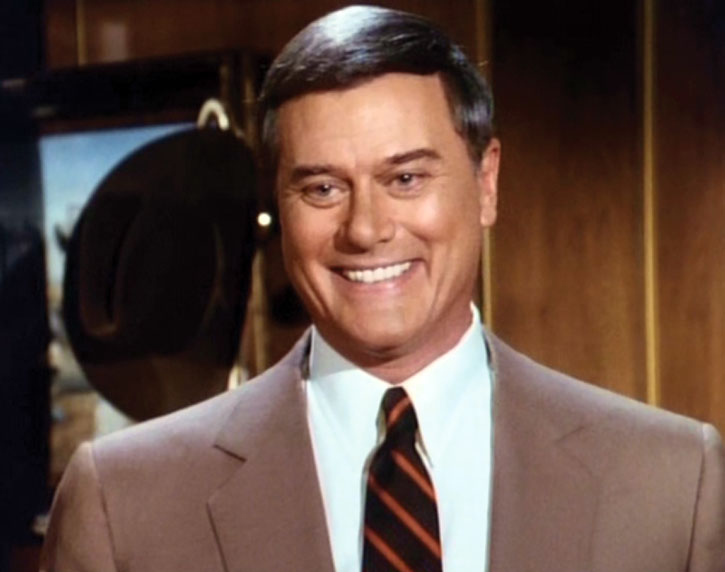 JR Ewing (Larry Hagman) grinning