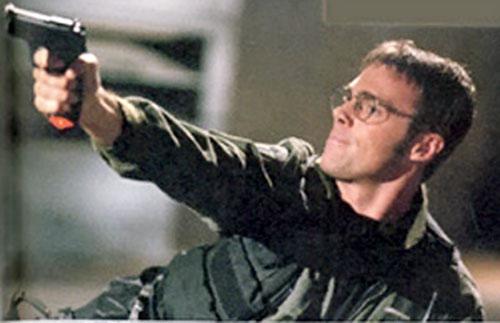 Dr. Daniel Jackson (Michael Shanks in Stargate) aiming a pistol
