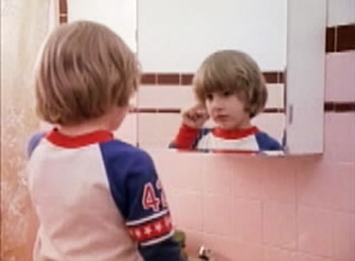 Danny Torrance (The Shining) and a bathroom mirror