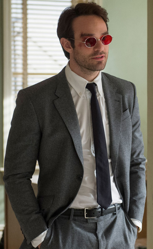 Daredevil (Charlie Cox on Netflix) grey suit red glasses