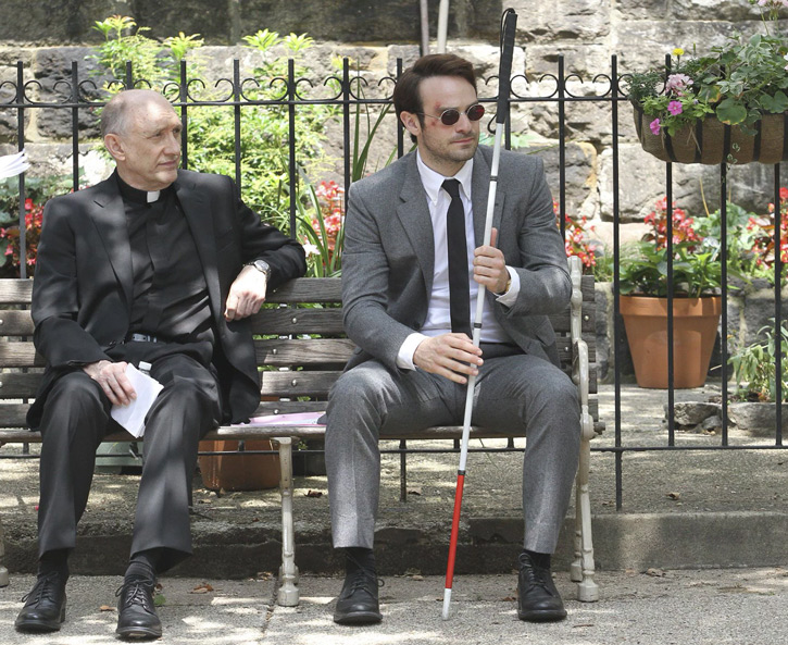 Daredevil (Charlie Cox on Netflix) with a priest on a bench