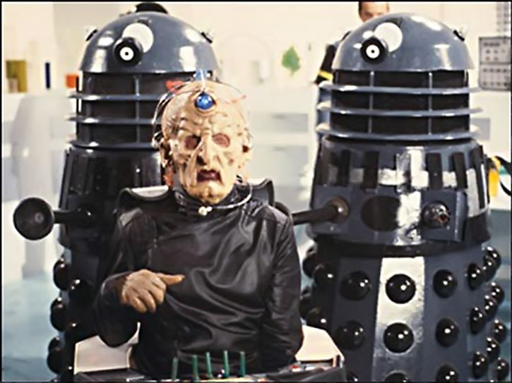 Davros with two black Daleks behind him