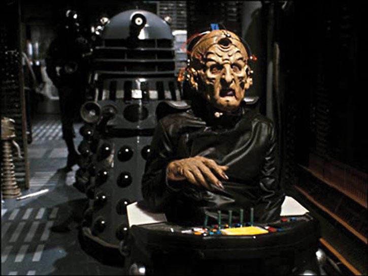 Davros escorted by a Dalek