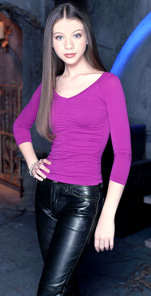 Dawn (Michelle Trachtenberg in Buffy) with a magenta top and leather pants