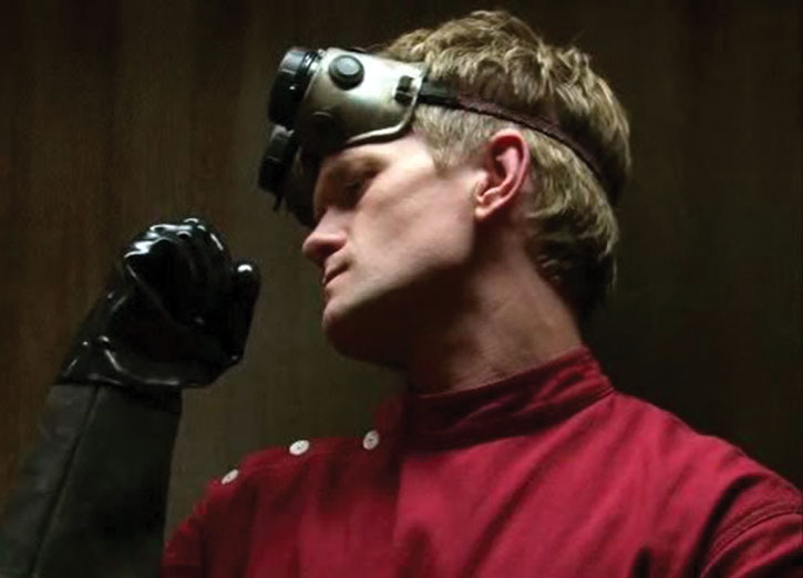 Doctor Horrible (Neil Patrick Harris) in red and in a dramatic pose