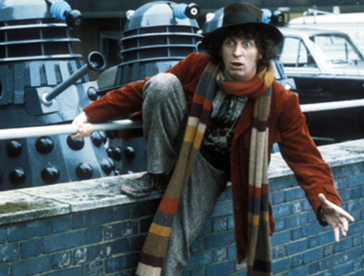 Doctor Who (Tom Baker) and two Daleks in a parking lot