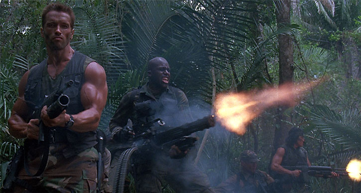 Mac (Bill Duke) fires Blaine's minigun