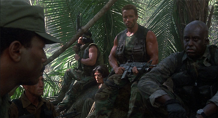 Dutch and his team in the jungle