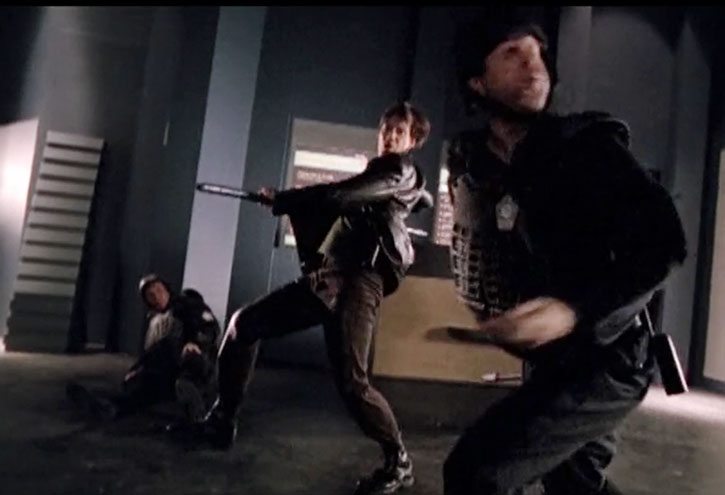 Dylan Hunt (Kevin Sorbo) fights two soldiers