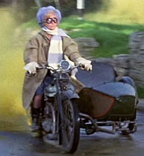 Eglantine Price (Angela Lansbury in Bedknobs and Broomsticks) driving a side car