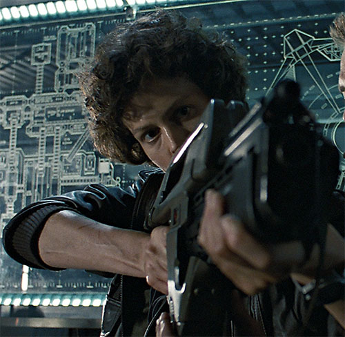 Ellen Ripley (Sigourney Weaver in Alien movies) aiming a pulse rifle