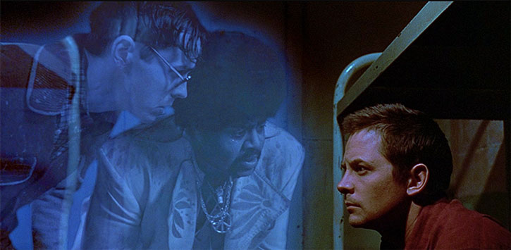 Frank Bannister (Michael J. Fox) and two ghosts
