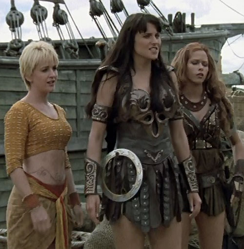Gabrielle (Renee O'Connor in Xena) with Xena and a boat