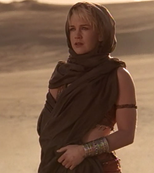 Gabrielle (Renee O'Connor in Xena) in the desert, with a cloak